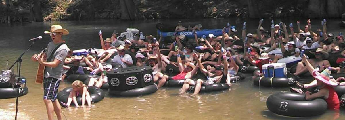July 2014: Organizers at Rockin' R River Rides on the Guadalupe River in New Braunfels estimated a couple thousand people showed up at Texas country star Roger Creager's annual birthday bash to break the record. The record was previously listed as an