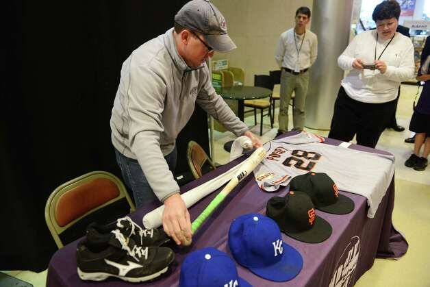 Cooperstown bound artifacts from the World Series games against the San Francisco Giants and Kansas City Royals are displayed by Brad Horn, vice president of communications for the National Baseball Hall of Fame and Museum, Thursday, Oct. 30, 2014, at Albany International Airport in Colonie, N.Y. The items included hats from Giants' Madison Bumgarner and manger Bruce Bochy; Royals' hats from Brandon Finnegan and Yordano Ventura; a Jersey from Buster Posey of the of the Giants; a pair of cleats from San Francisco Giants pitcher Jeremy Affeldt worn in game 7 and bats from Giants' Hunter Pence and Royals' Salvador Perez. (Will Waldron/Times Union) Photo: WW / 00029255A