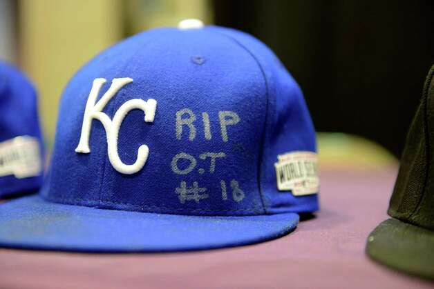 Yordano Ventura's baseball hat is displayed with a group of Cooperstown bound artifacts from World Series games against the San Francisco Giants and the Kansas City Royals Thursday, Oct. 30, 2014, at Albany International Airport in Colonie, N.Y. The hats pays tribute to Cardinals outfielder Oscar Taveras. The other items included hats from Giants' Madison Bumgarner and manger Bruce Bochy; Royals hat from Brandon Finnegan; a Jersey from Buster Posey of the of the Giants; a pair of cleats from San Francisco Giants pitcher Jeremy Affeldt worn in game 7 and bats from the Giants' Hunter Pence and Royals Salvador Perez. (Will Waldron/Times Union) Photo: WW / 00029255A