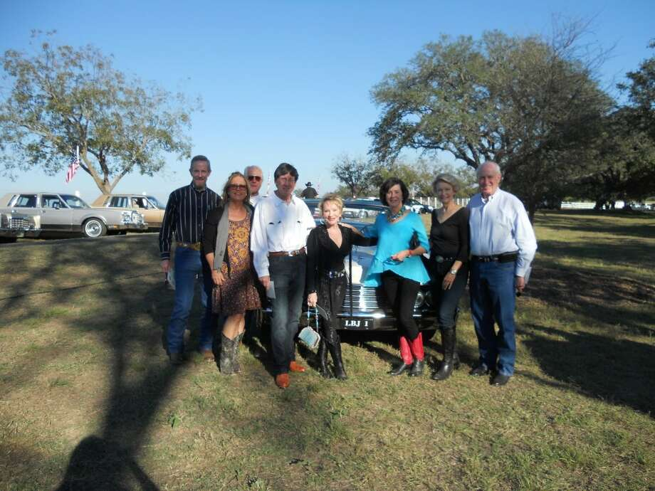 Pictured left to right are Scott Rushing, Julie Jarvis, Jim Hill, Bubba Cook, Jo Cook, Kelle Hill, Millie Wilson and Leonard Wilson at Friends of the LBJ National Historical Park Barbecue and one of LBJ's Lincoln Continentals.