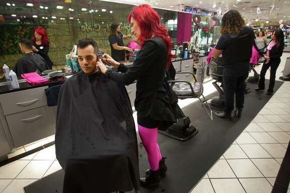 Scott Allen has his hair cut by Diana Barragan at Visible Changes in the Galleria on Wednesday, Oct. 8, 2014, in Houston. Maryanne McCormack began with one salon in 1977 at the Greenspoint Mall in Houston. The company has grown to include 17 salons across the state of Texas.