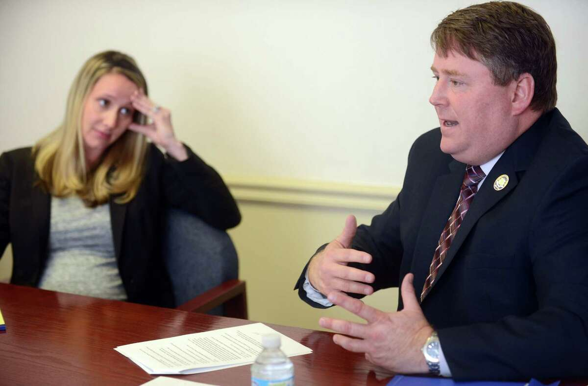 Incumbent state Rep. Dan Carter (R-2) answers questions as Democratic challenger Candace Fay looks on during their editorial board interview at the News-Times.