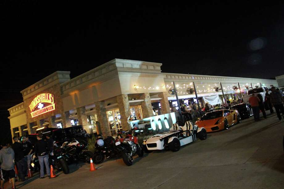 Houston Car Cruise held its Monday night get-together at Bombshells' Webster location. Patrons could eye the collection of cars while enjoying music.