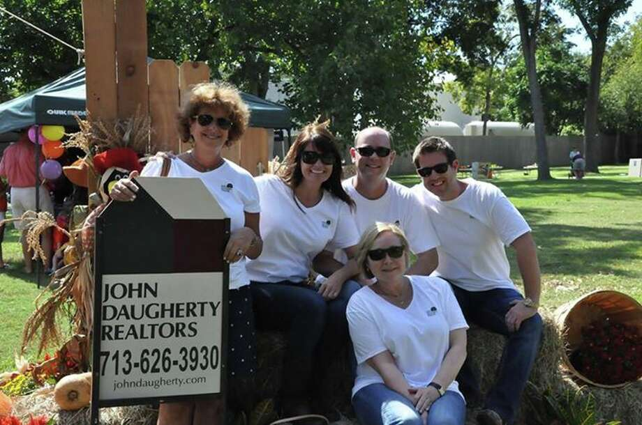 Left to right are Margo Cunningham, Sabrina Elias, Rob Ginn, Chris Foster and Carmon White (in front) attending the John Daugherty, Realtors annual Fall Festival.