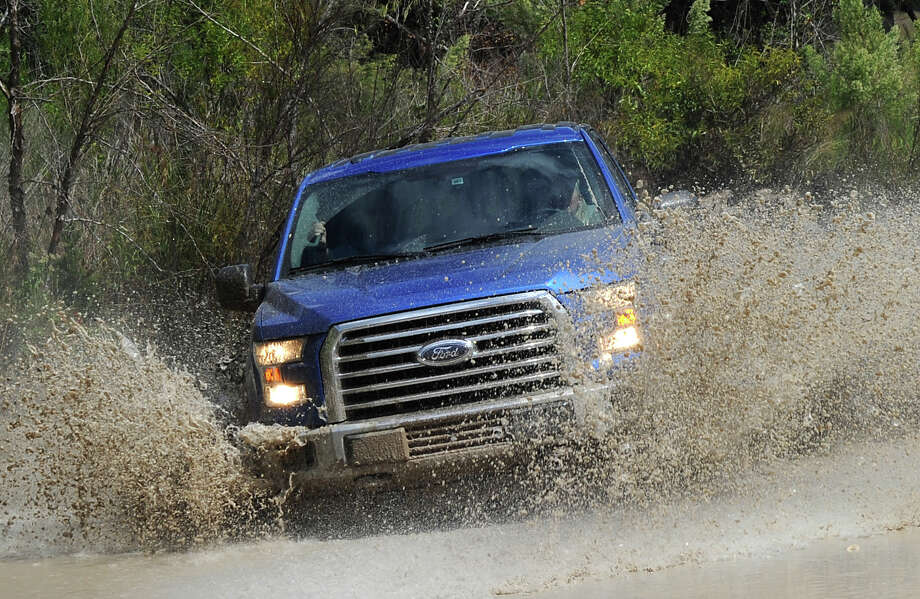 Ford's 2015 F-150 was taken on an off-road course with up-and-downhill sections, a track of partially buried logs, as well as through water and deep-mud.