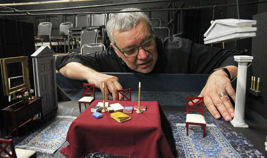"Ric Slocum shows the set model of ""Ghosts."" Photo: TOM REEL / Tom Reel / San Antonio Express-News"