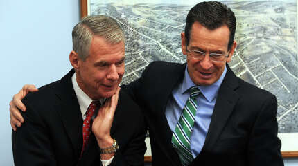 Gov. Dannel Malloy stands with Stephen Angel, Chairman, President and Chief Executive Officer of Praxair, Inc. during a meeting at the Greater Danbury Chamber of Commerce, in Danbury, Conn. Oct. 31, 2014. Praxair announced they will keep their world headquarters in Danbury, and will invest $65 million to build a new 100,000 square foot corporate facility.