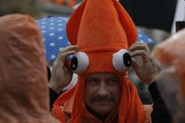 Scott Stewart, of Santa Cruz, wears an orange squid hat at the Giants Parade celebrating the 2014 World Series victory in San Francisco, Calif., on Friday, October 31, 2014.