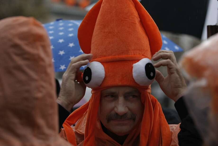 Scott Stewart, of Santa Cruz, wears an orange squid hat at the Giants Parade celebrating the 2014 World Series victory in San Francisco, Calif., on Friday, October 31, 2014. Photo: Daniel E. Porter, The Chronicle