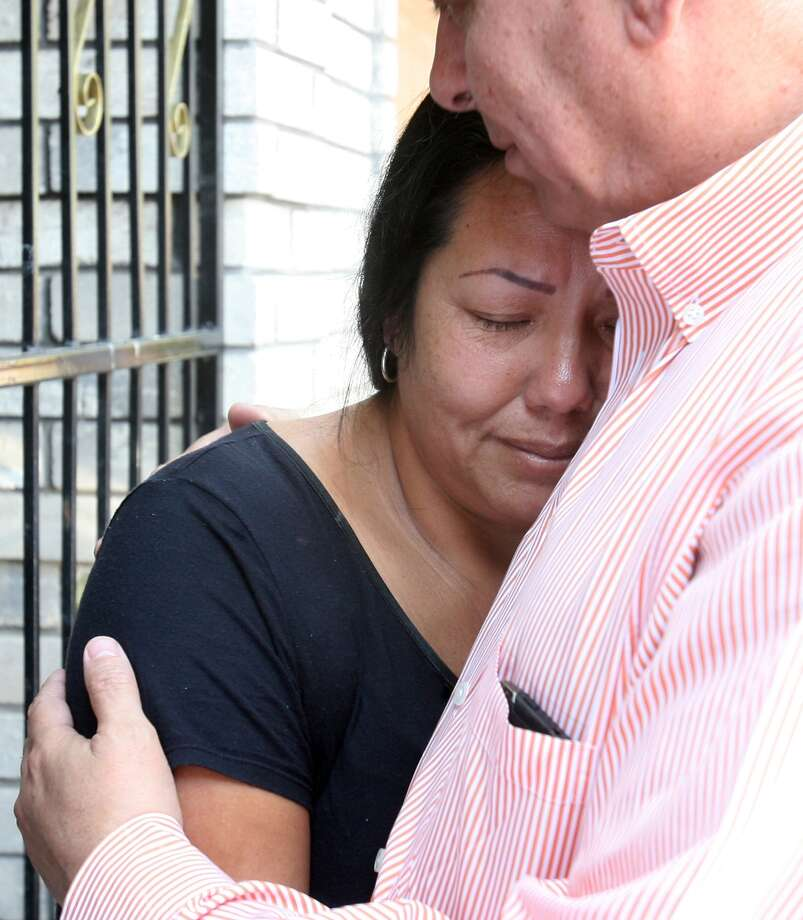 Raquel Alvarado is comforted as she talks about her children, who were found dead near Matamoros. Photo: Joel Martinez / Associated Press / POOL The Monitor