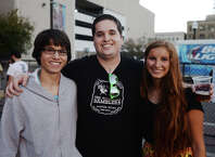 "Logan Lusignan, Chris Badger, and Hannah Bell, left to right, pose for a photo at Rocktoberfest. The first annual Rocktoberfest was held at the Jefferson Theater on Thursday night. The miniature music festival included performances by Stone Cold, Ramblin' Boys, Jenny and the Reincarnation, and We Were Wolves. St. Arnold was on hand to serve up beer and the performances were followed by a showing of ""The Rocky Horror Picture Show"" inside the Jefferson. Photo taken Thursday 10/30/14 Jake Daniels/@JakeD_in_SETX"