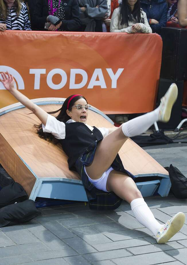 "LIVE FROM NEW YORK, IT'S ... ""Today Show"" co-anchor Natalie Morales taking a spill while dressed up as the famously awkward ""Saturday Night Live"" character Mary Katherine Gallagher during a Halloween episode of NBC's news show. Photo: Charles Sykes, Associated Press"
