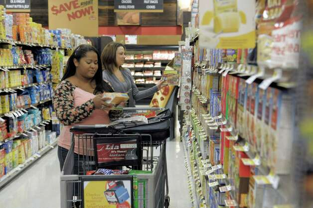 Priscila Melendez, left, and Melissa Verga, founders of a local charitable venture called Couponers for a Cause, shop at ShopRite on Tuesday, Oct. 28, 2014, in Niskyuna, N.Y.  (Paul Buckowski / Times Union) Photo: Paul Buckowski / 00029144A