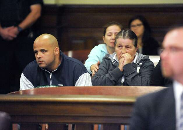 Family of Vanessa Milligan , Marcel Milligan (uncle), left, and Patricia Sunkes (grandmother), right, listen during the bail hearing for Gabriel Vega, charged with the murder of Vanessa Milligan, in Rensselaer County Court on Friday Oct. 31, 2014 in Troy, N.Y. (Michael P. Farrell/Times Union) Photo: Michael P. Farrell / 00029271A
