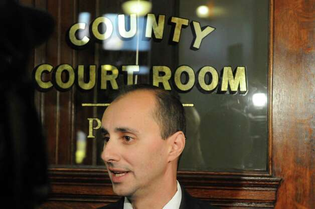 Rensselaer County 1st assistant district attorney Carmelo M. Laquidara speaks with the media following the bail hearing for Gabriel Vega, charged with the murder of Vanessa Milligan, in Rensselaer County Court on Friday Oct. 31, 2014 in Troy, N.Y. (Michael P. Farrell/Times Union) Photo: Michael P. Farrell / 00029271A