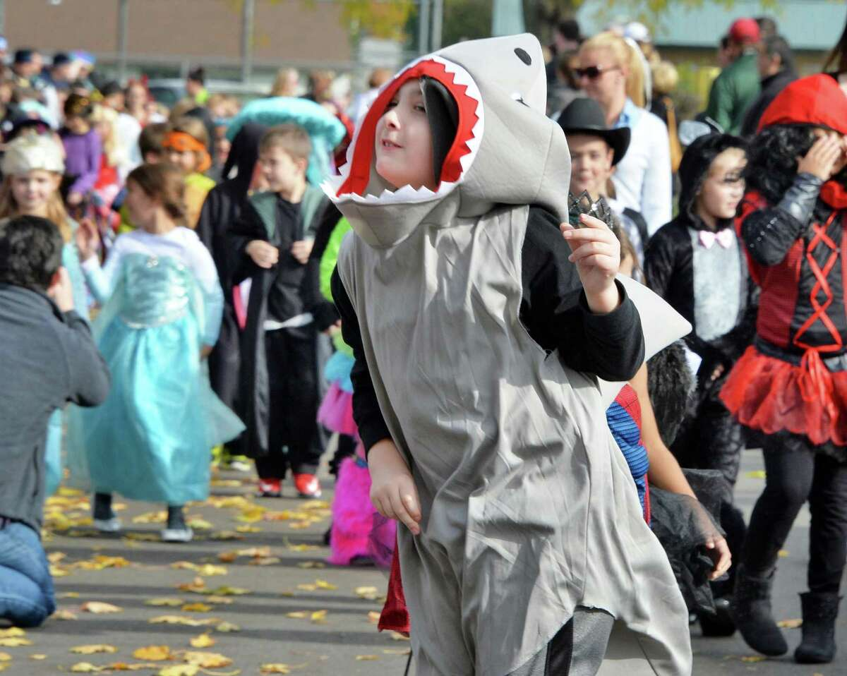 Division Street Elementary School second grader Storm Hass is dressed as the shark from Jaws during their annual Halloween parade Friday Oct. 31, 2014, in Saratoga Springs, NY. (John Carl D'Annibale / Times Union)