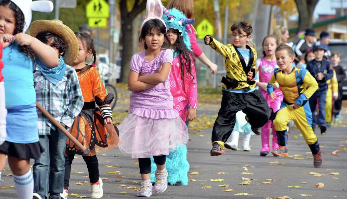 Costumed students march in the annual Division Street Elementary School Halloween parade Friday Oct. 31, 2014, in Saratoga Springs, NY. (John Carl D'Annibale / Times Union)