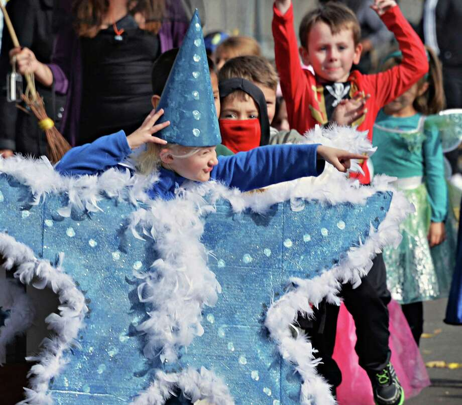 Dressed as a star, kindergartener Emma Brobston, center, leads the Division Street Elementary School Halloween parade Friday Oct. 31, 2014, in Saratoga Springs, NY.  (John Carl D'Annibale / Times Union) Photo: John Carl D'Annibale / 00029297A