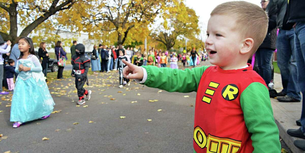 Three-year-old Blake Lobacz of Saratoga Springs waves to the big kids during the Division Street Elementary School Halloween parade Friday Oct. 31, 2014, in Saratoga Springs, NY. (John Carl D'Annibale / Times Union)