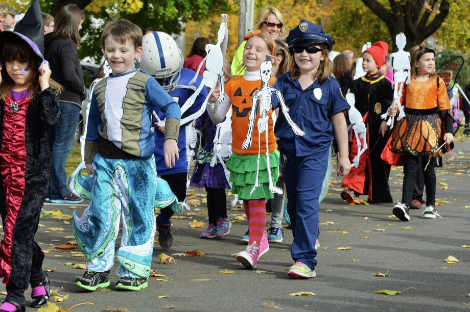 Costumed students march in the annual Division Street Elementary School Halloween parade Friday Oct. 31, 2014, in Saratoga Springs, NY.  (John Carl D'Annibale / Times Union) Photo: John Carl D'Annibale / 00029297A