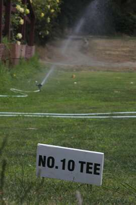 A water sprinkler with a kicker is seen watering grass at No. 10 Tee at the Gleneagles Golf Course on Monday, July 7,  2014 in San Francisco, Calif.  The area at No. 10 Tee is outfitted with 4 water heads but one sprinkler with a kicker is being used in order to conserve water.