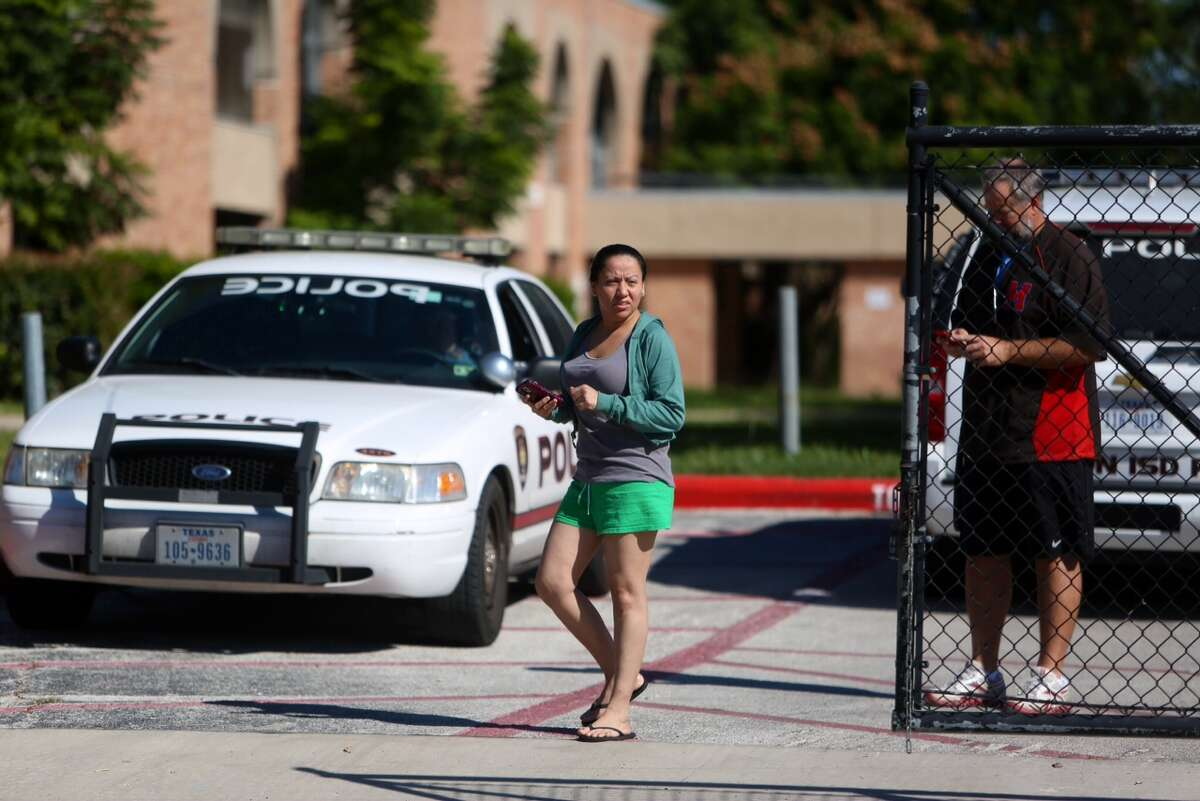 Houston Police work the scene of a stabbing at James Madison High School on Friday, Oct. 31, 2014.