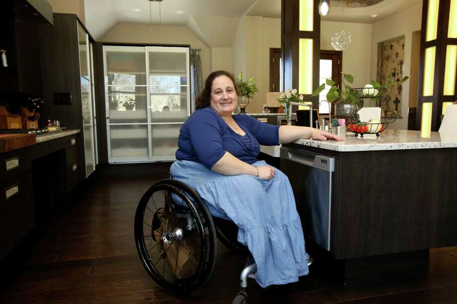 Vanessa Vance worked with two interior designers and her builder when remodeling her home to give it the contemporary look she wanted and to make it better accommodate her and her wheelchair. Photo: Helen L. Montoya, Staff / San Antonio Express-News / ©2013 San Antonio Express-News