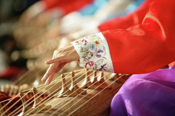 "A group of 15 musicians from Korea's National Gukak Center will perform on native instruments such as the gayageum at 1:30 p.m. Sunday at the Museum of Fine Arts, Houston to help celebrate the opening of the exhibition ""Treasures From Korea: Arts and Culture of the Joseon Dynasty, 1392-1910."""