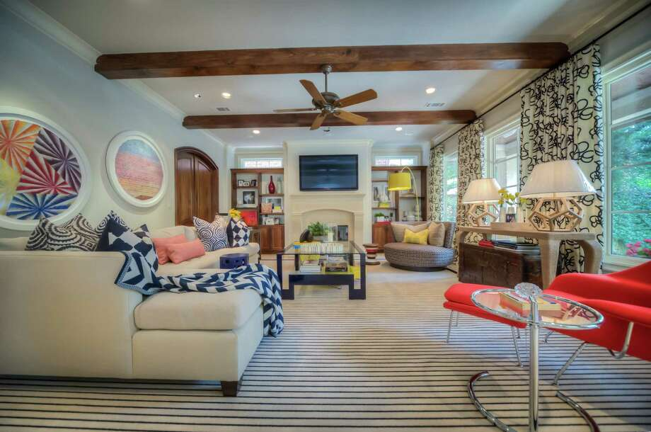 The living room of this West University home is filled with primary colors and bold patterns.
