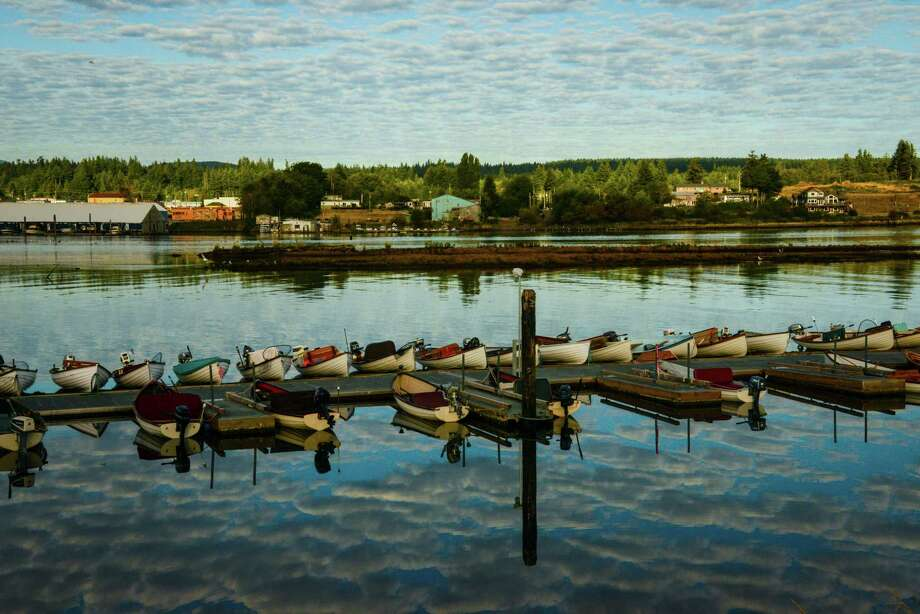 Rowboats that take anglers out for early morning fishing on the Campbell River line the Tyee Club's dock. Photo: Jill K. Robinson / ONLINE_CHECK
