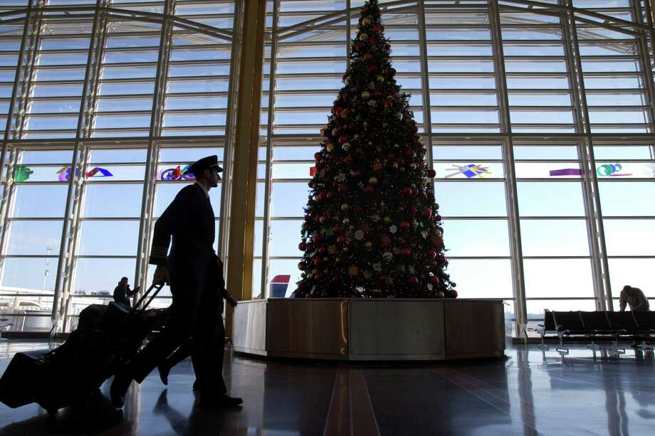 A pilot walks through Reagan National Airport near Washington on Christmas Eve last year.  A report warns gridlock will soon be the norm at U.S. airports. Photo: Jacquelyn Martin, STF / AP