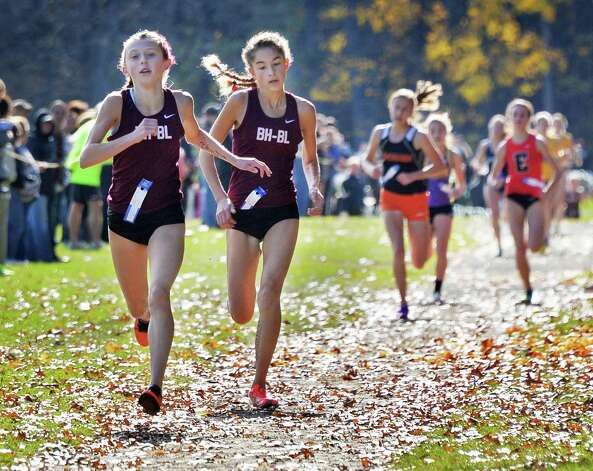 Burnt Hill's Emily Digman, left, and team mate Ava Scott finish first and second in the girl's Class B Section II Cross Country Championships at Saratoga Spa State Park Friday Oct. 31, 2014, in Saratoga Springs, NY.  (John Carl D'Annibale / Times Union) Photo: John Carl D'Annibale / 00029251A
