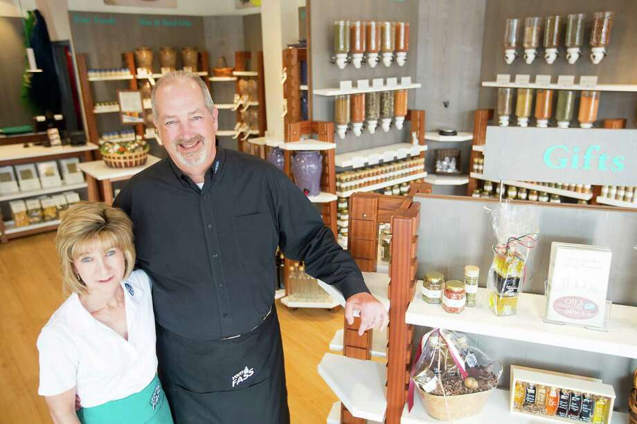 Brian Moorhead and his wife, Larita, own the new Vom Fass store in Rice Village that offers cask-aged vinegars, oils, select wines, and spirits and liqueurs, spices and gourmet foods. Photo: Johnny Hanson / © 2014  Houston Chronicle