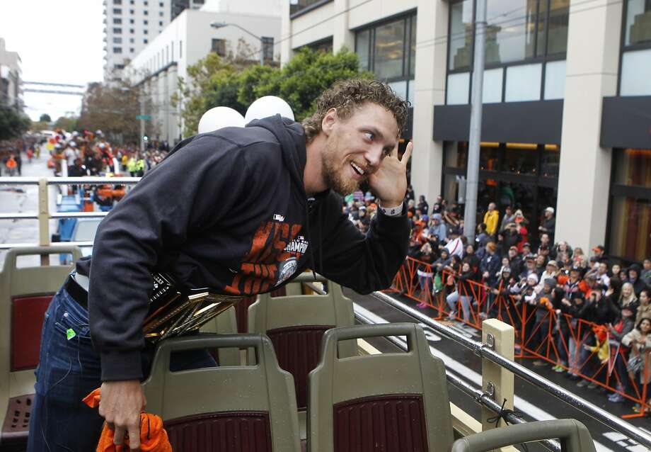 Hunter Pence listens to the cheers from the crowd during the Giants' World Series victory parade in San Francisco, Calif. on Friday, Oct. 31, 2014. The Giants captured their third championship in five years after defeating the Kansas City Royals in a seven-game series. Photo: Paul Chinn, The Chronicle