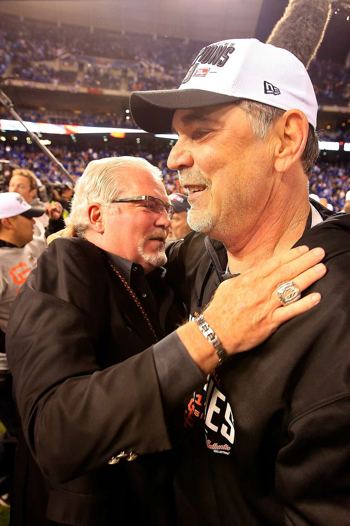 KANSAS CITY, MO - OCTOBER 29: Manager Bruce Bochy #15 of the San Francisco Giants celebrates on the field with general manager Brian Sabean after defeating the Kansas City Royals 3-2 to win Game Seven of the 2014 World Series at Kauffman Stadium on October 29, 2014 in Kansas City, Missouri. (Photo by Jamie Squire/Getty Images)