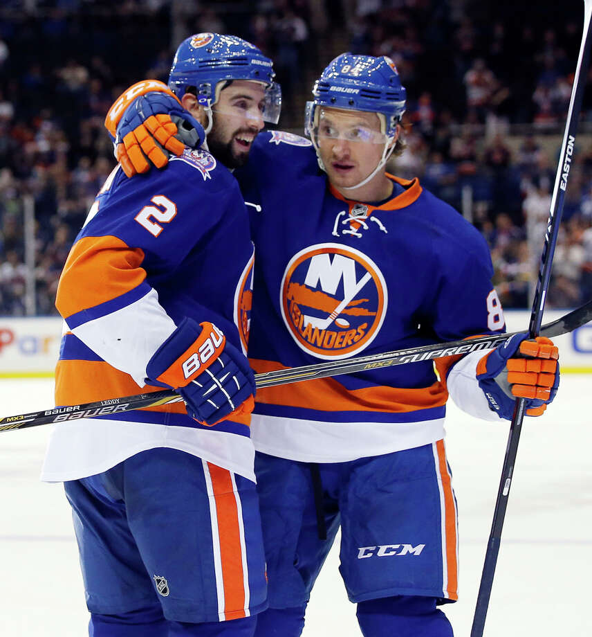 Defenseman Nick Leddy (2), who has five points, and center Mikhail Grabovski, who has six points, are two of the reasons the Islanders are off to a strong start this season. Photo: Kathy Willens / Associated Press / AP