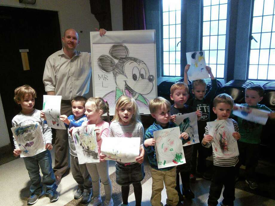 Local graphics and art instructor, Phil Lohmeyer, came to First Church Preschool on recently, to do a cartooning workshop with 4- and 5-year olds. The children learned to draw Mickey Mouse. Photo: Contributed Photo / Greenwich Time Contributed