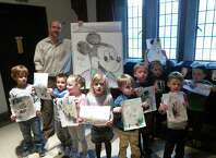 Local graphics and art instructor, Phil Lohmeyer, came to First Church Preschool on recently, to do a cartooning workshop with 4- and 5-year olds. The children learned to draw Mickey Mouse.