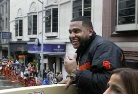 Pablo Sandoval smiles to the crowd during the Giants' World Series victory parade in San Francisco, Calif. on Friday, Oct. 31, 2014. The Giants captured their third championship in five years after defeating the Kansas City Royals in a seven-game series.