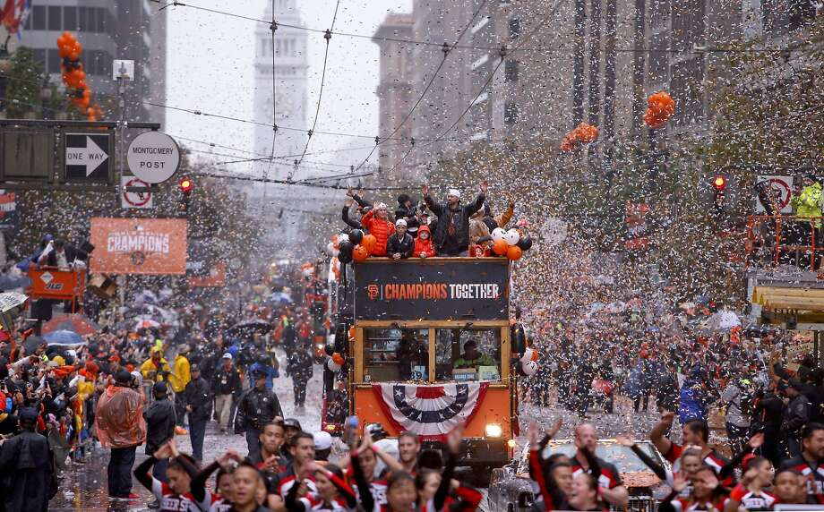 Giants' pitcher Jeremy Affeldt, waves to fans along the confetti filled route, as the world champion San Francisco Giants celebrate their victory with a parade through downtown San Francisco, Calif., on Friday Oct. 31, 2014. Photo: Michael Macor, The Chronicle
