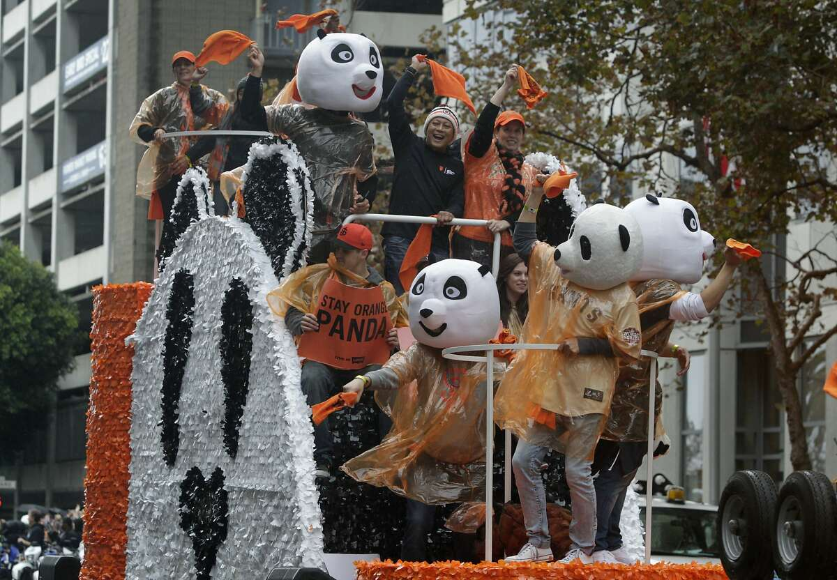 The panda head fans ride on their own float during the Giants' World Series victory parade in San Francisco, Calif. on Friday, Oct. 31, 2014. The Giants captured their third championship in five years after defeating the Kansas City Royals in a seven-game series.