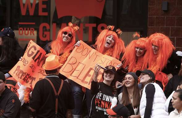 "Self described ""Gamer Babes"" with Giants' orange hair, (l to r) Brittany and Barbara Thayer, Jeanne Heintz and Angela Mullin cheer along the route, as the world champion San Francisco Giants celebrate their victory with a parade through downtown San Francisco, Calif., on Friday Oct. 31, 2014."