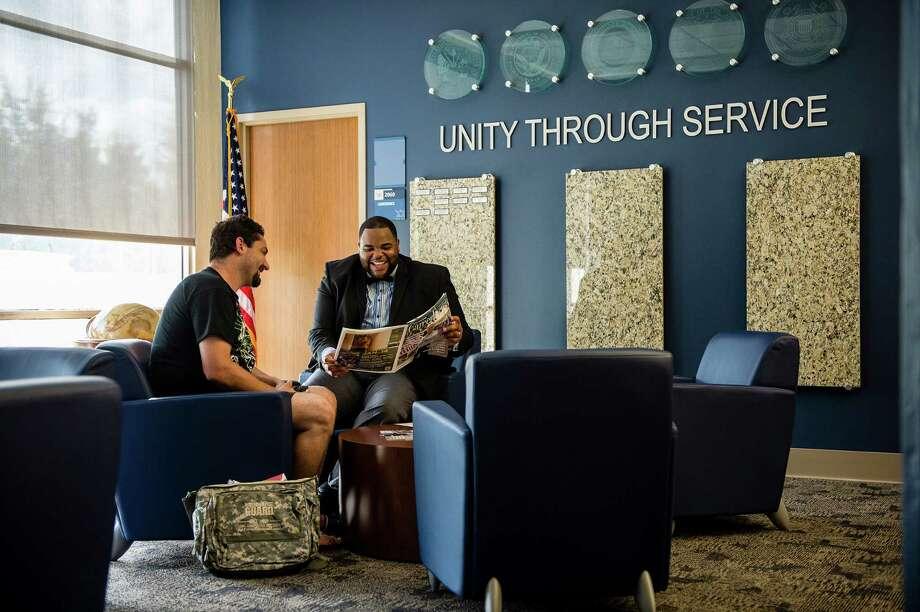 Student Andrew Thomas (left) visits with Eugene Bernard, San Jacinto College South Campus veteran success coordinator.