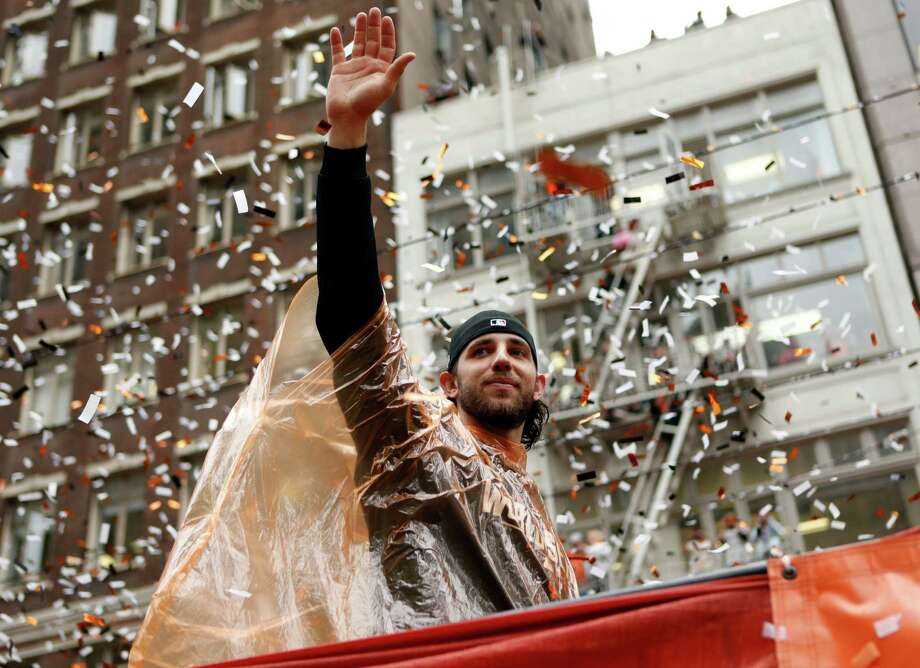 Madison Bumgarner, who won a pickup truck as World Series MVP, is a small town guy who appropriately rode on the back of flatbed truck down Market Street. Photo: Scott Strazzante / The Chronicle / ONLINE_YES