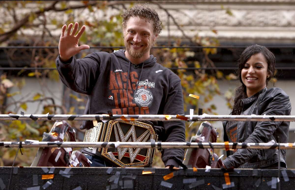 Hunter Pence waves to fans along the route, as the world champion San Francisco Giants celebrate their victory with a parade through downtown San Francisco, Calif., on Friday Oct. 31, 2014.