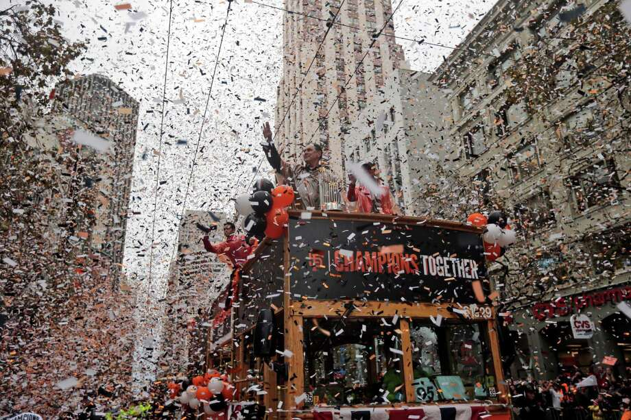 San Francisco Giants manager Bruce Bochy, top center, waves as he carries the 2014 World Series trophy during the victory parade for baseball's 2014 World Series champions, Friday, Oct. 31, 2014, in San Francisco. (AP Photo/Marcio Jose Sanchez) Photo: Marcio Jose Sanchez / Associated Press / AP