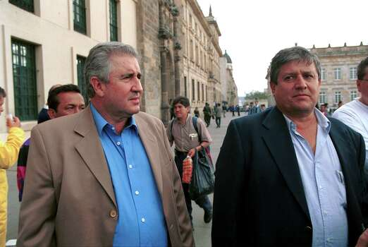 393824 02: Juan David Ochoa (L) and his brother Jorge Luis, the brothers of alleged Colombian drug king pin Fabio Ochoa, leave the couthouse August 28, 2001 in Bogota. Ochoa family members appealed a federal court ruling handed down on August 27 that authorizes the extradition of Fabio Ochoa to the United States to stand trial. Photo: Carlos Villalon, Getty Images / Getty Images North America
