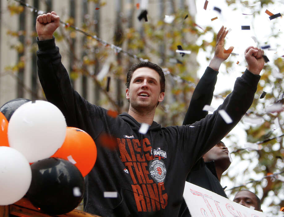 San Francisco Giants' Buster Posey during World Series Parade on Market Street in San Francisco. on Friday, October 31, 2014. Photo: Scott Strazzante / The Chronicle / ONLINE_YES