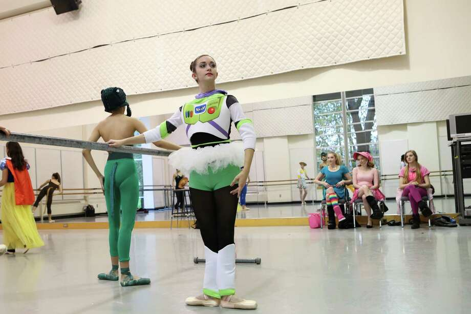 "Madison Abeo, 18, dresses up as Buzz Lightyear from ""Toy Story"" during dance practice. Students of the Pacific Northwest Ballet School's Professional Division abandoned their strict dress codes to dress up in the spirit of Halloween for their morning class on Friday, Oct. 31, 2014 in Seattle, WA. Photo: ANNA ERICKSON, SEATTLEPI.COM / SEATTLEPI.COM"