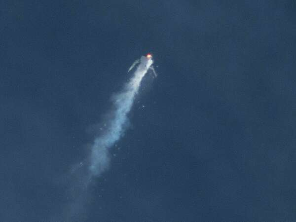 The Virgin Galactic SpaceShipTwo rocket explodes in the air during a test flight on Friday, Oct. 31, 2014. The explosion killed a pilot aboard and seriously injured another while scattering wreckage in Southern California's Mojave Desert, witnesses and officials said.